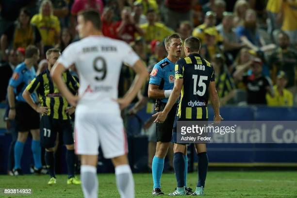 Referee Alex King talks to Alan Baro about a decision during the round 11 ALeague match between the Central Coast and the Western Sydney Wanderers at...