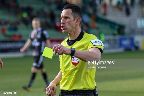 Referee Alexander Harkam shows the yellow card during tipico Bundesliga match between SV Mattersburg and LASK at Pappelstadion on March 8, 2020 in...