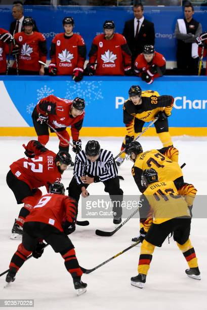 Referee Alexander Otmakhov of Russia between Derek Roy Eric O'Dell Rene Bourque of Canada and Yasin Ehliz Dominik Kahun Frank Mauer of Germany during...