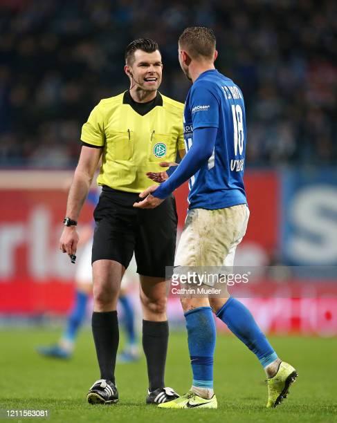 Referee Alexander Sather and John Verhoek of Hansa Rostock talk during the 3 Liga match between Hansa Rostock and Eintracht Braunschweig at...