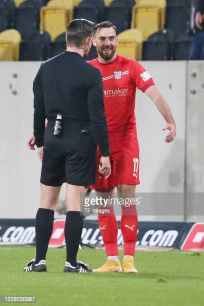 referee Alexander Sather and Morris Schroeter of FSV Zwickau speak during the 3 Liga match between Dynamo Dresden and FSV Zwickau at...