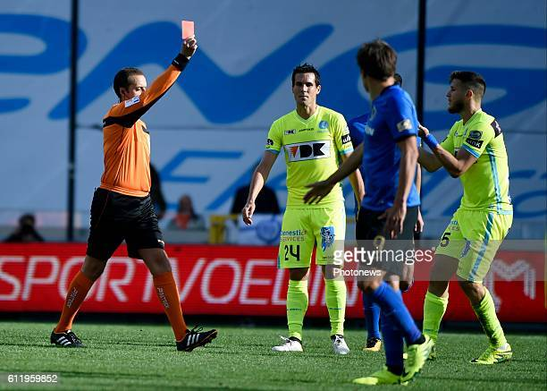 referee Alexandre Boucaut gestures shows a red car to Rami Gershon defender of KAA Gent pictured during Jupiler Pro League match between Club Brugge...
