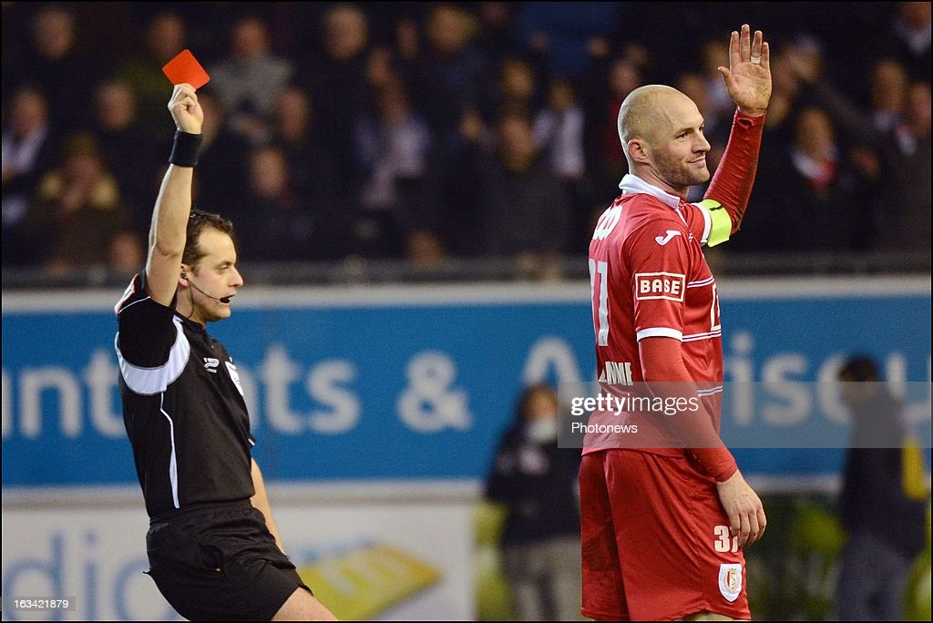 Referee Alexandre Boucaut shows the red card to Standard de Liege's Jelle Van Damme during the Jupiler Pro League match between OH Leuven and Standard de Liege on March 9 in Leuven, Belgium.