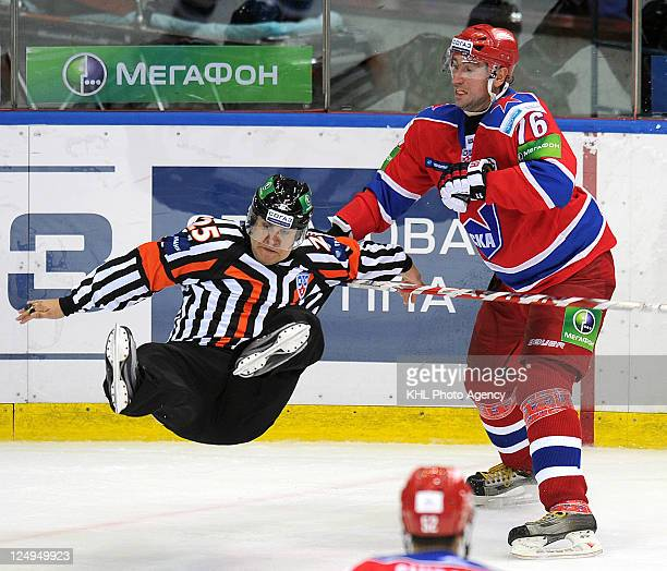 Referee Alexei Belov collapses with Alexander Guskov of the CSKA Moscow during the game against the Avangard Omsk during the KHL Championship...