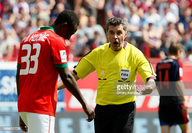 Referee Alexei Nikolayev speaks to Dame N'Doye of FC Lokomotiv Moscow during the Russian Premier League match between FC Lokomotiv Moscow and PFC...