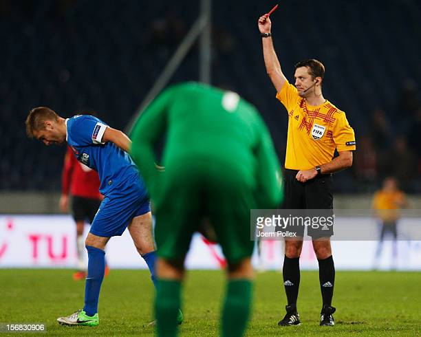 Referee Alexey Kulbakov shows the red card to Rasmus Bengtsson of Twente during the UEFA Europa League Group L match between Hannover 96 and FC...