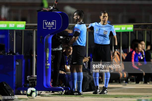 Referee Alexis Herrera reviews a play with VAR during the Copa America Brazil 2019 group B match between Colombia and Qatar at Morumbi Stadium on...