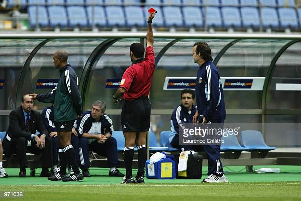 Referee Ali Bujsaim shows the red card to Argentina substitute Claudio Caniggia during the Argentina v Sweden Group F World Cup Group Stage match...