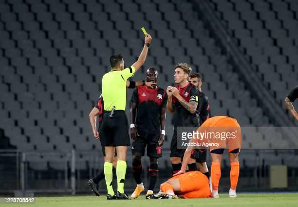 Referee Ali Sansalan shows yellow card to Lucas Biglia of Fatih Karagumruk during the Turkish Super Lig week 3 football match between Fatih...