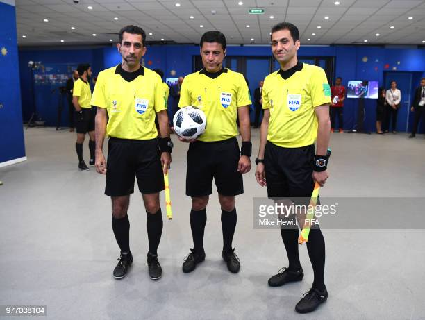 Referee Alireza Faghani and his assistants Reza Sokhandan and Mohammadreza Mansouri are seen in the tunnel at half time during the 2018 FIFA World...