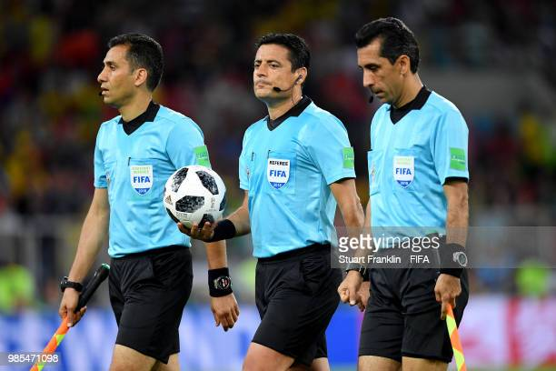Referee Alireza Faghani and his assistants walk off at half time on during the 2018 FIFA World Cup Russia group E match between Serbia and Brazil at...