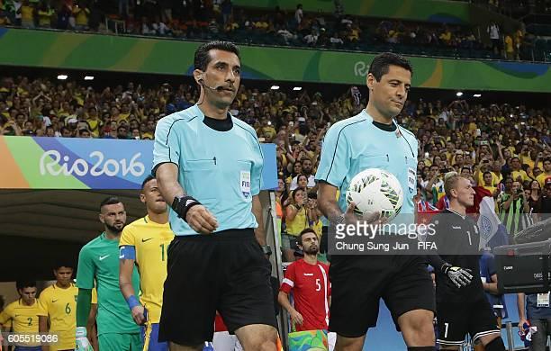 Referee Alireza Faghani assistant referees walks out for the Men's Football match between Denmark and Brazil on Day 5 of the Rio 2016 Olympic Games...