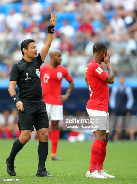 Referee Alireza Faghani gestures during the 2018 FIFA World Cup Russia 3rd Place Playoff match between Belgium and England at Saint Petersburg...
