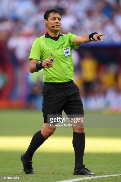 Referee Alireza Faghani gestures during the 2018 FIFA World Cup Russia Round of 16 match between France and Argentina at Kazan Arena on June 30 2018...