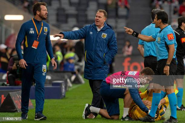 Referee Alireza Faghani gestures towards a Mariners coach Alex Stajcic and a staff member after a tackle non Mariners Jordan Murry by Wanderers...