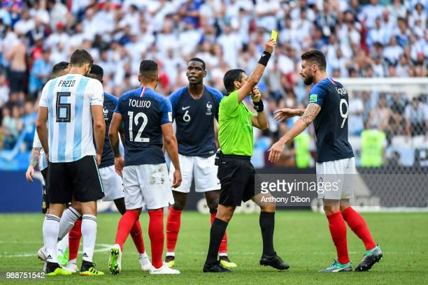 Referee Alireza Faghani gives a yellow card during the FIFA World Cup Round of 16 match between France and Argentina at Kazan Arena on June 30 2018...