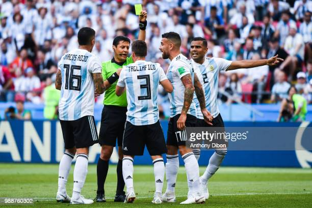 Referee Alireza Faghani gives a yellow card to Nicolas Otamendi of Argentina during the FIFA World Cup Round of 16 match between France and Argentina...