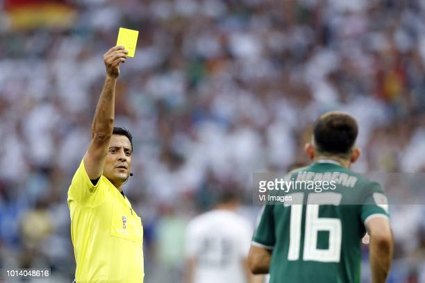 referee Alireza Faghani Hector Herrera of Mexico during the 2018 FIFA World Cup Russia group F match between Germany and Mexico at the Luzhniki...