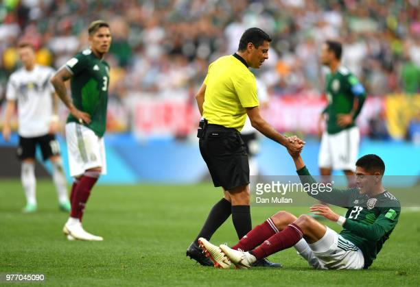 Referee Alireza Faghani helps Edson Alvarez of Mexico during the 2018 FIFA World Cup Russia group F match between Germany and Mexico at Luzhniki...