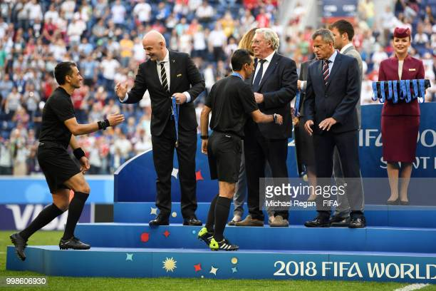 Referee Alireza Faghani is awarded by FIFA President Gianni Infantino General Secretary of the Royal Belgian Football Association Gerard Linard and...