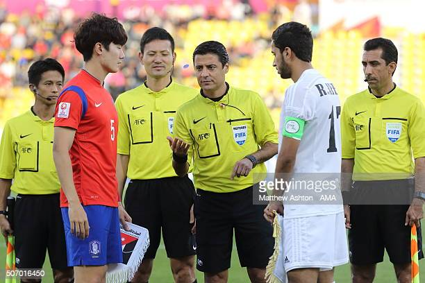 Referee Alireza Faghani of Iran does the coin toss with captains Yeon Jei Min of South Korea and Rajaei Ayed Fadel Hasan of Jordan before the AFC U23...