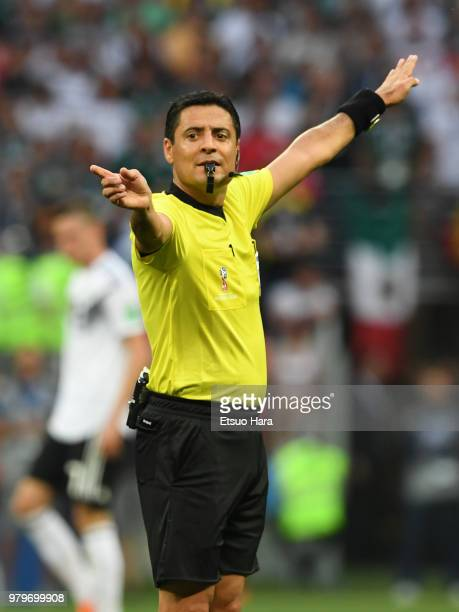 Referee Alireza Faghani of Iran gestures during the 2018 FIFA World Cup Russia group F match between Germany and Mexico at Luzhniki Stadium on June...