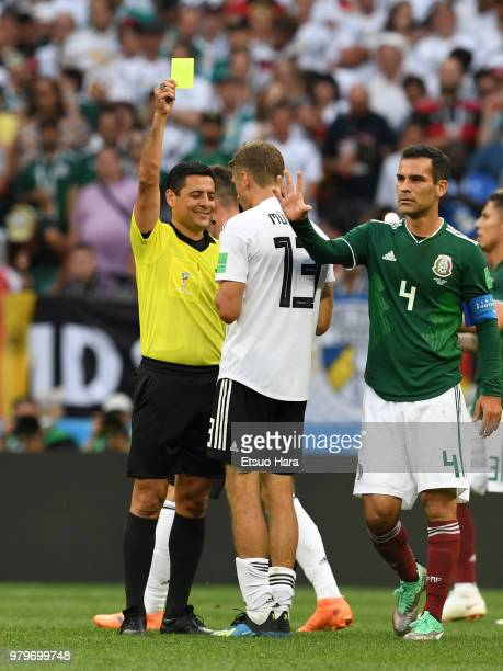Referee Alireza Faghani of Iran shows an yellow card to Thomas Mueller of Germany during the 2018 FIFA World Cup Russia group F match between Germany...
