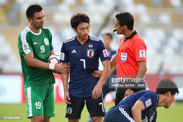 Referee Alireza Faghani speaks to Gaku Shibasaki of Japan during the AFC Asian Cup Group F match between Japan and Turkmenistan at Al Nahyan Stadium...