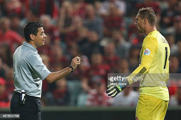 Referee Alireza Faghani speaks to Wanderers goal keepr Ante Covic during the Asian Champions League final match between the Western Sydney Wanderers...