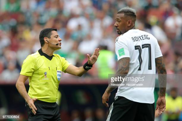 Referee Alireza Faghani speaks with Jerome Boateng of Germany during the 2018 FIFA World Cup Russia group F match between Germany and Mexico at...