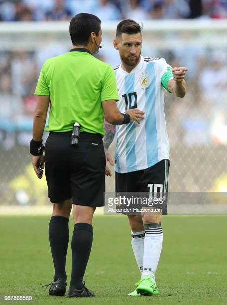 Referee Alireza Faghani speaks with Lionel Messi of Argentina during the 2018 FIFA World Cup Russia Round of 16 match between France and Argentina at...