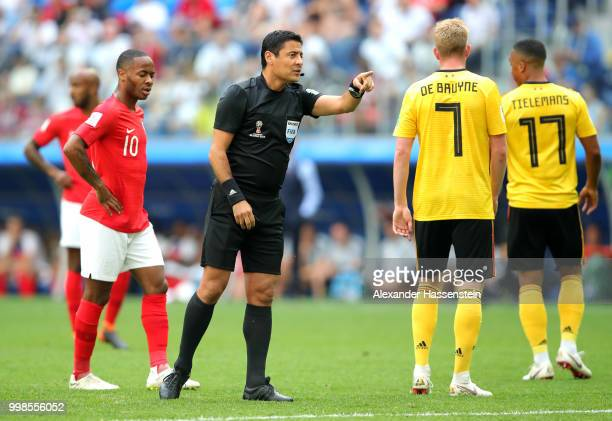 Referee Alireza Faghani talks to Kevin De Bruyne of Belgium during the 2018 FIFA World Cup Russia 3rd Place Playoff match between Belgium and England...