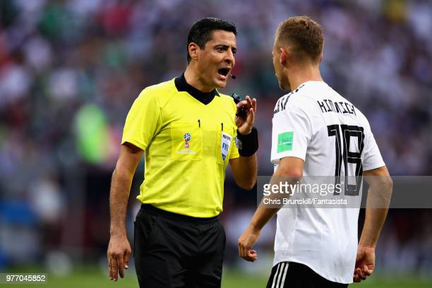 Referee Alireza Faghani talks with Joshua Kimmich of Germany during the 2018 FIFA World Cup Russia group F match between Germany and Mexico at...