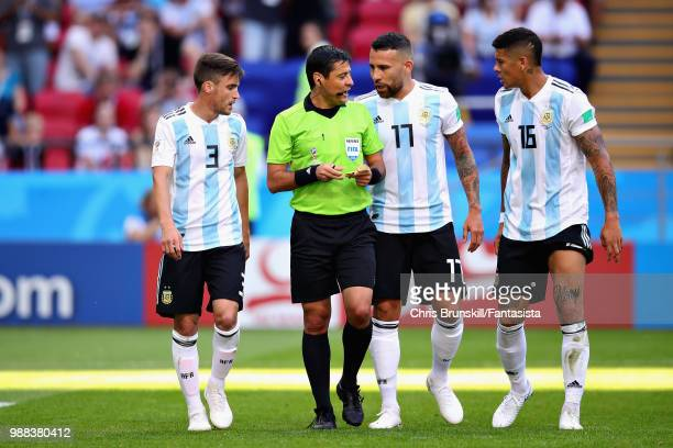 Referee Alireza Faghani talks with Nicolas Tagliafico Nicolas Otamendi and Marcos Rojo all of Argentina during the 2018 FIFA World Cup Russia Round...