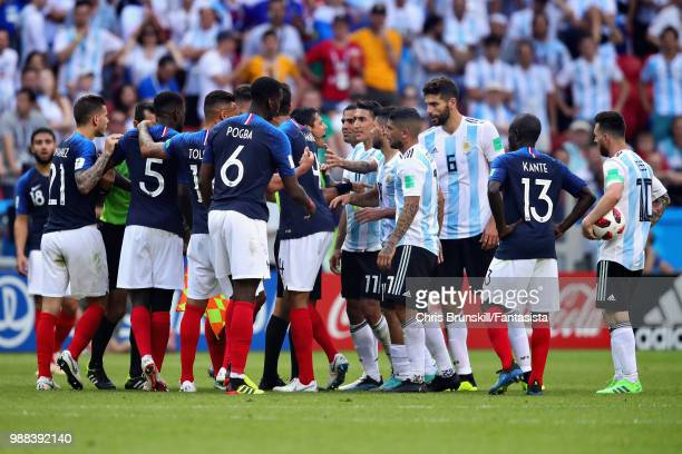 Referee Alireza Faghani tries to calm the teams down during the 2018 FIFA World Cup Russia Round of 16 match between France and Argentina at Kazan...