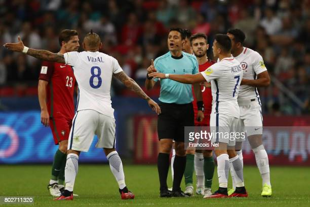 Referee Alireza Faghareacts speaks to Arturo Vidal of Chile and Alexis Sanchez of Chile during the FIFA Confederations Cup Russia 2017 SemiFinal...