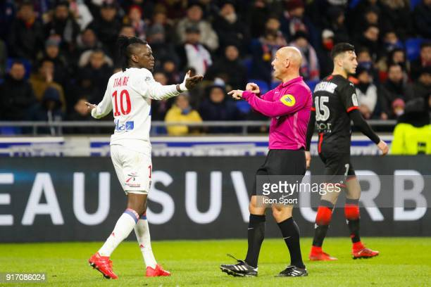 Referee Amaury Delerue and Bertrand Traore of Lyon during the Ligue 1 match between Olympique Lyonnais and Stade Rennes at Parc Olympique on February...