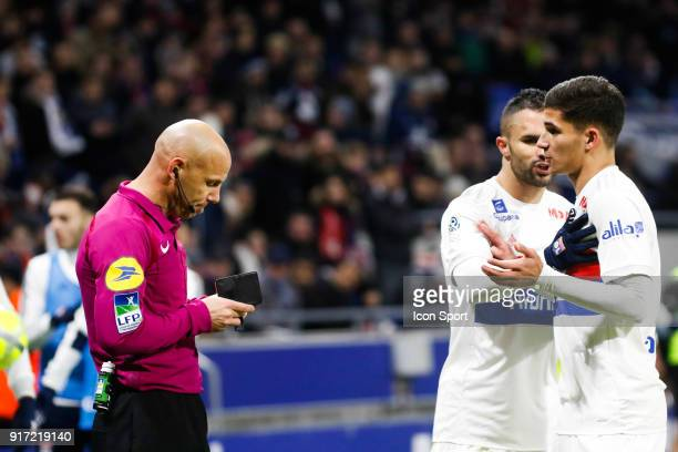 Referee Amaury Delerue and Houssem Aouar of Lyon and Jérémy Morel of Lyon during the Ligue 1 match between Olympique Lyonnais and Stade Rennes at...