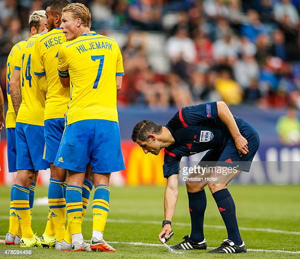 Referee Anastasio Tasos Sidiropoulos uses foam spray during the UEFA Under21 European Championship between Italy and Sweden at Andruv Stadium on June...