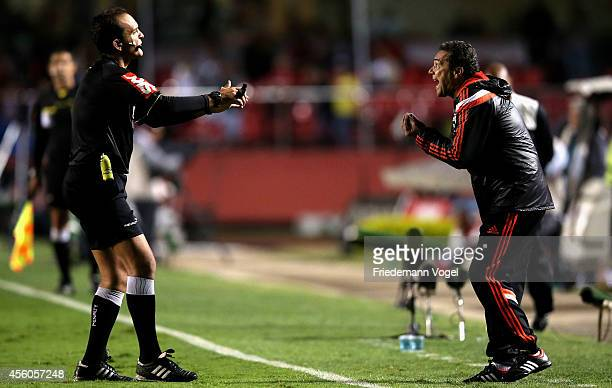 Referee Andre Luiz de Freitas Castro speaks with head coach Luxemburgo of Flamengo during the match between Sao Paulo and Flamengo for the Brazilian...