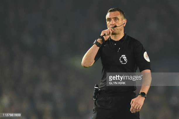 Referee Andre Mariner officiates during the English Premier League football match between Brighton and Hove Albion and Cardiff City at the American...
