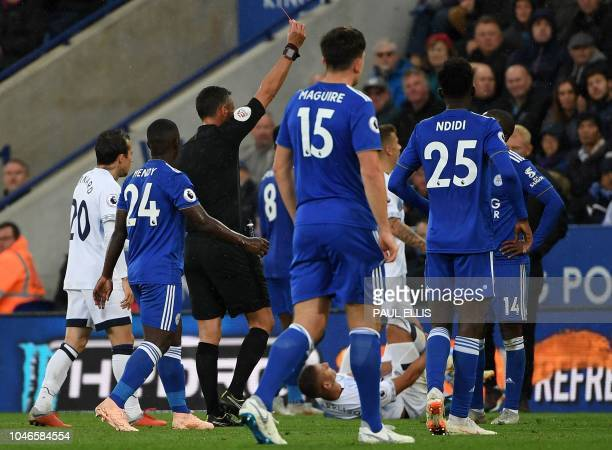 Referee Andre Mariner shows a red card to Leicester City's Englishborn Jamaican defender Wes Morgan during the English Premier League football match...
