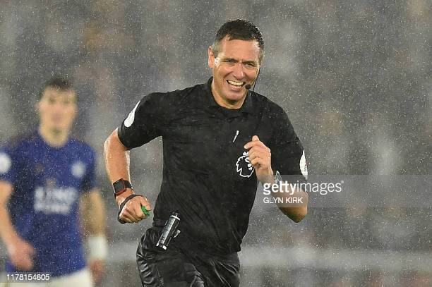 Referee Andre Marinner reacts after falling over during the English Premier League football match between Southampton and Leicester City at St Mary's...