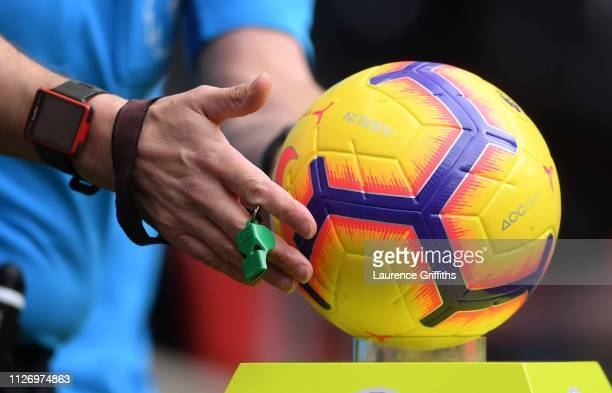 Referee, Andre Marriner collects the match ball ahead of the Premier League match between Tottenham Hotspur and Newcastle United at Wembley Stadium...