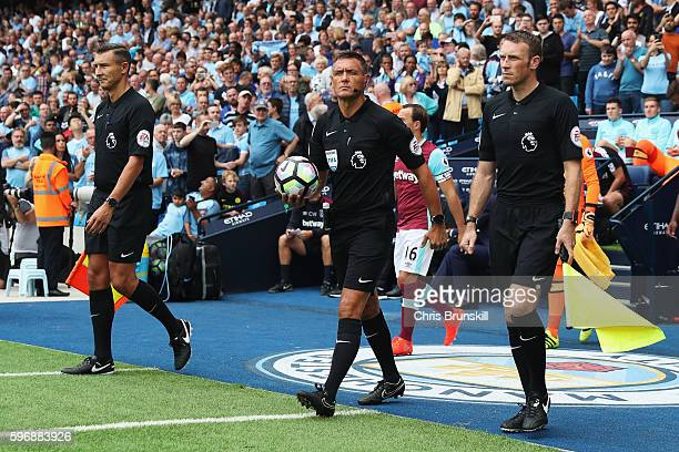 Referee Andre Marriner collects the match ball from the plinth during the Premier League match between Manchester City and West Ham United at Etihad...
