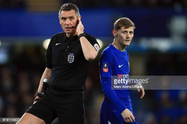 Referee Andre Marriner consults the VAR as Kyle Scott of Chelsea looks on during the FA Cup 5th Round match between Chelsea and Hull City at Stamford...