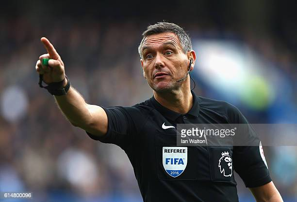 Referee Andre Marriner during the Premier League match between Chelsea and Leicester City at Stamford Bridge on October 15 2016 in London England