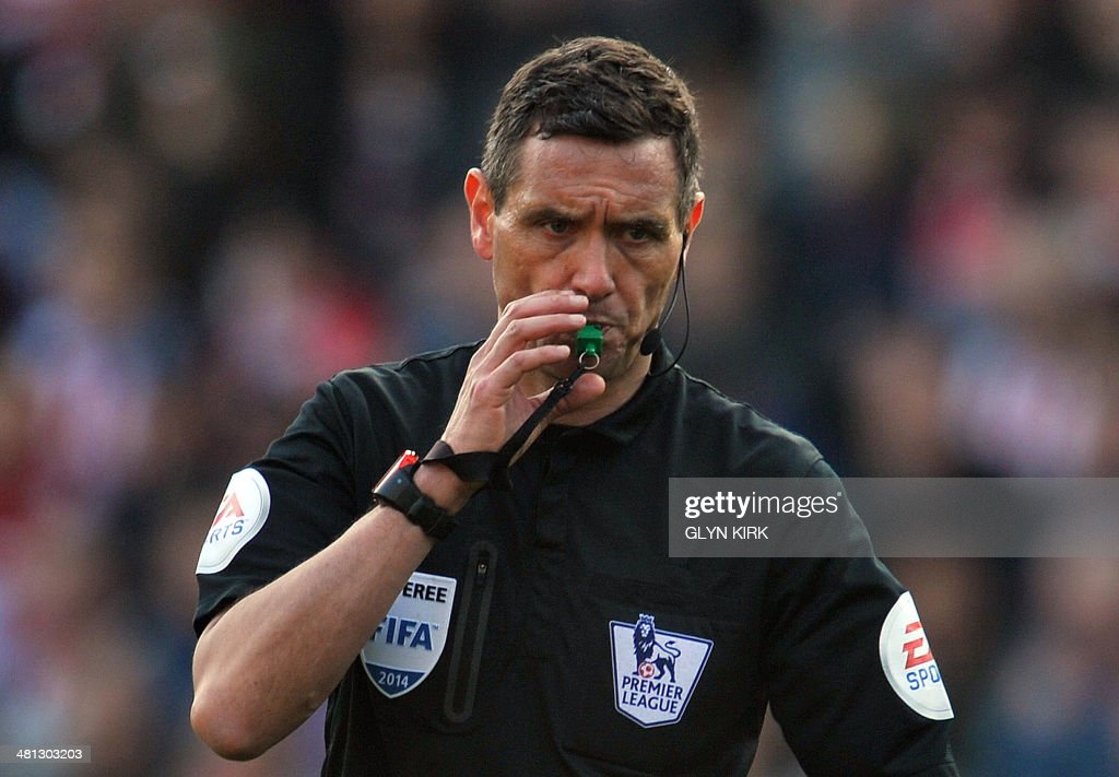 Referee Andre Marriner gestures during the English Premier League football match between Southampton and Newcastle United at St Mary's Stadium in Southampton, southern England on March 29, 2014. Southampton won 4-0. AFP PHOTO / GLYN KIRK USE. No use with unauthorized audio, video, data, fixture lists, club/league logos or live services. Online in-match use limited to 45 images, no video emulation. No use in betting, games or single club/league/player publications. /