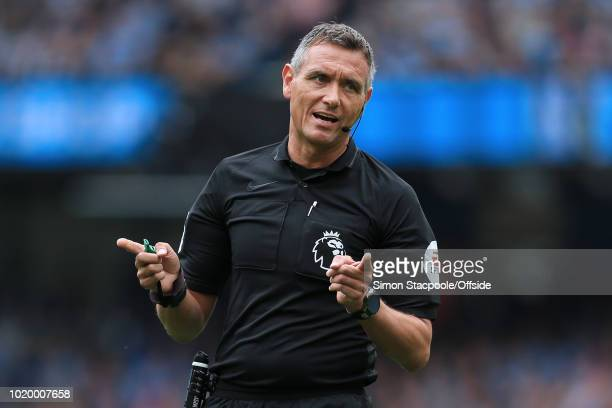Referee Andre Marriner gestures during the Premier League match between Manchester City and Huddersfield Town at the Etihad Stadium on August 19 2018...