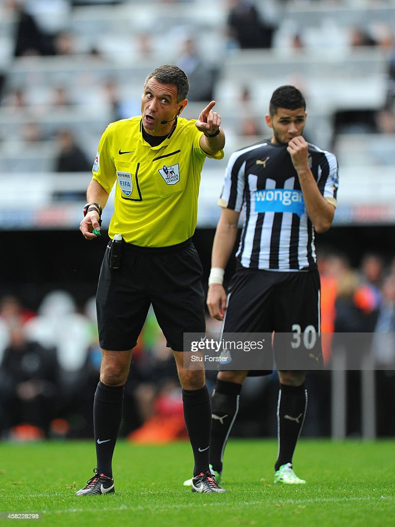 Referee Andre Marriner in action during the Barclays Premier League match between Newcastle United and Liverpool at St James' Park on November 1, 2014 in Newcastle upon Tyne, England.
